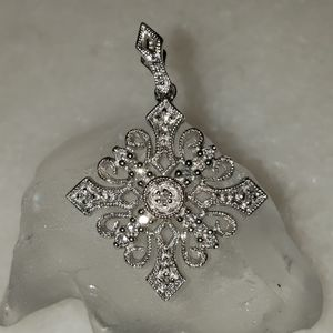 10k White Gold + Diamond Snowflake Pendant